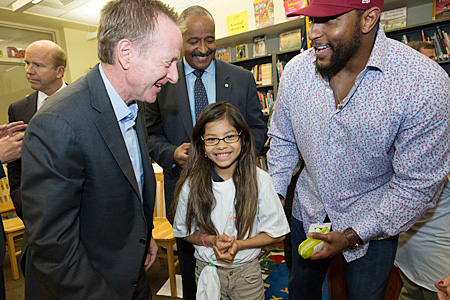 VTL CEO Austin Beutner, Michael Thomas of City Schools, and Ray Lewis with a student at Hampstead Hill Academy